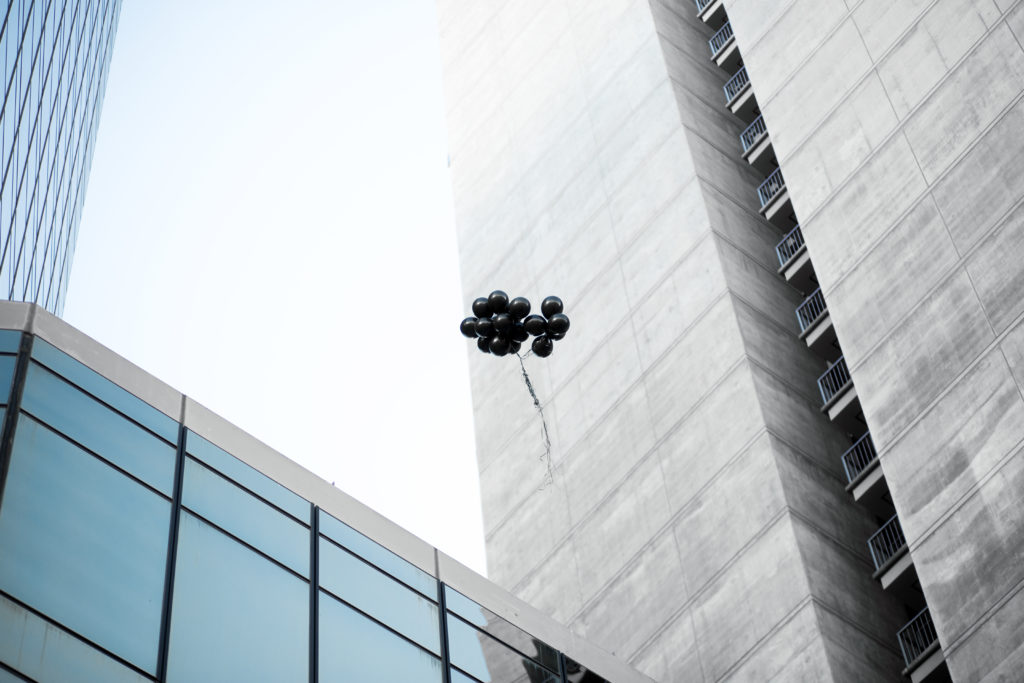Black Balloons Floating in the air