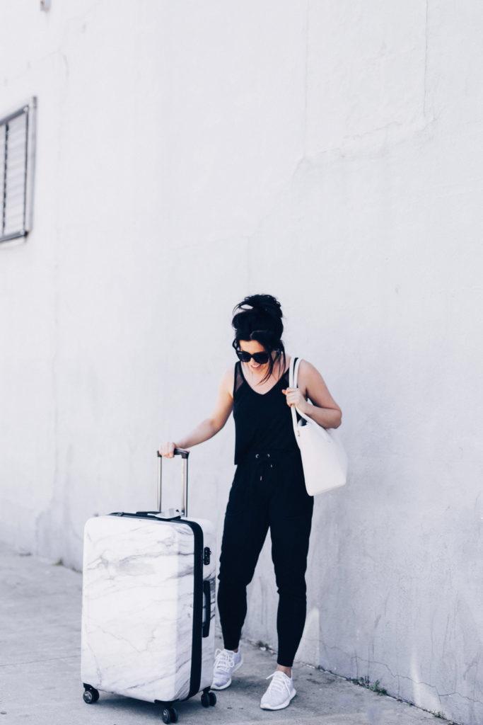 Erin Aschow Travel Tips Calpak marble luggage, dagne dover bag, adore me track suit, adidas shadow tubular