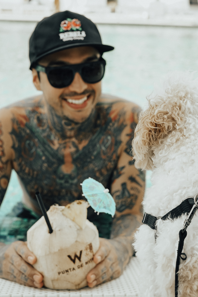 Doug the Dog hanging out by pool with Tony Perry