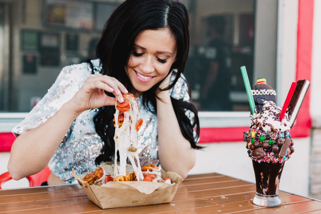 Erin Aschow Revenge Bakery Travel & Food Blogger eating Pizza Fries from Funky Fries & Burgers