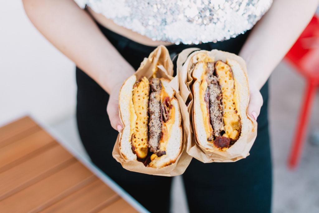 Blogger eating an Bacon Mac N Cheese Burger at Funky Fries & Burgers